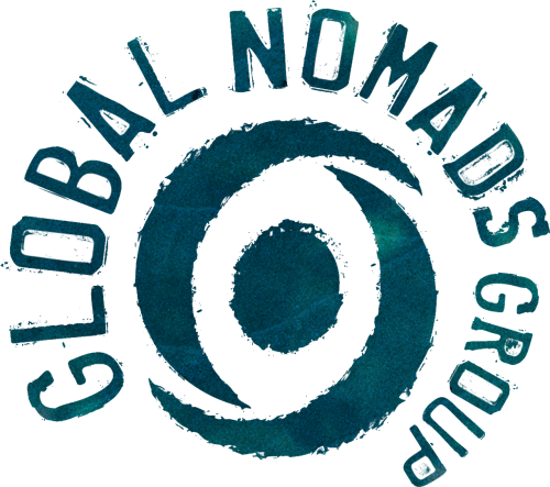 a roughly stamped circle with two crescents encircling it. the words 'global nomads group' also encircles in a crescent around teh top