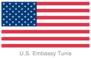 """Image shows the US flag with the words """"U.S. Embassy Tunis"""" below"""
